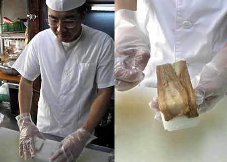 穴子寿司を押しています